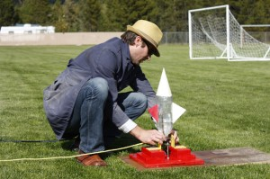 Science teacher John Baker with bottle rocket experiment Valemount Secondary mountain school