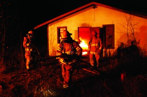 Valemount Volunteer Fire Department working hard to put out the fire on Main St.