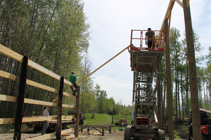 Rising from the ashes; community rebuilds McBride barn