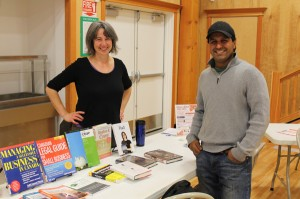 The Small Business Expo happened last week in McBride. Naomi Balla-Boudreau discussing available books with Councillor Raj Basran at the Library display table. Photo: Chris Parker