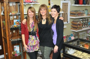 Melanie Chitty, centre, with  some of her staff at Unique Boutique, Caitlin Beddington (left) and Shauna Tremblay Photo submitted by Paul Johnson.
