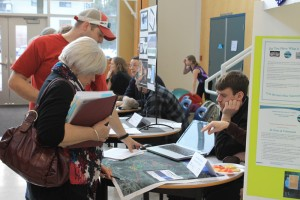 Members of the local adjudication committee for the Columbia Basin Trust's  Community Initiatives and Affected Areas program as well as members of the public got to check out proposals from local groups on Thursday, before the groups made their presentations. Photo: Korie Marshall