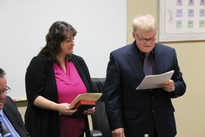 Counc. Robert Callaghan reads his oath of office in December.