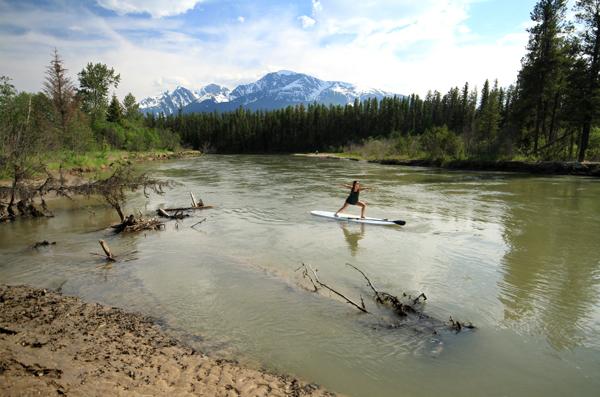 Donalda practising yoga on her paddle board.