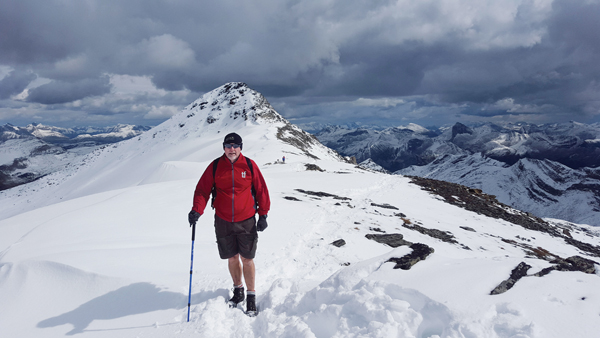 Fred Fox in front of the summit