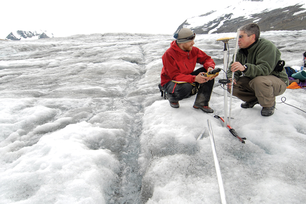 Photo courtesy UNBC The tip of the Castle Creek glacier near McBride has receded about 750 meters since research began 50 years ago. Castle Creek is unique in North America because it leaves behind rings that show the annual glacial retreat. Above: PhD student Matt Beedle (left) and professor Brian Menounos measure changes in glacier thickness using GPS.