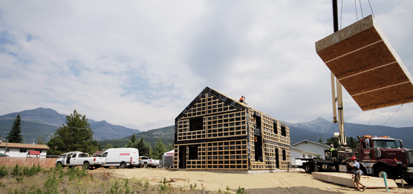 Valemount's first Passive House is set to be completed in spring 2016. In this summer 2015 photo, a crane lifts a roof panel. The pre-fab building envelope took 3 days to assemble.