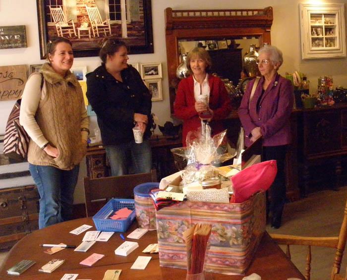 Photo by Monica Marcu Sasha Scott, Janice Seydell, Judy Stephens, and Isabel Bonniville take part in International Women's Day celebrations in McBride.
