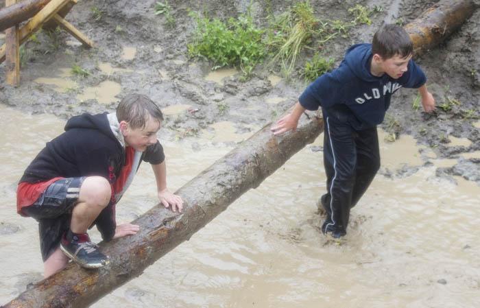 Photo: Evan Matthews Jevon Bricker and Garrett Nash hop this log rather than slide underneath.