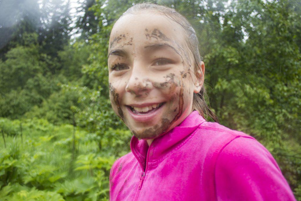 Photo: Evan Matthews Abigail Cinnamon smiles, despite being covered in mud.