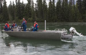 A Kinder Morgan spill response team motors out on the Fraser River in a jet boat to set up a decontamination unit. / EVAN MATTHEWS