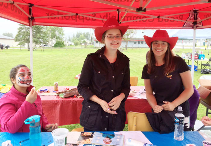 Hannah Day and Jasmine Vogel helped out the library with children's facepainting and activities in Steve Kolida Park