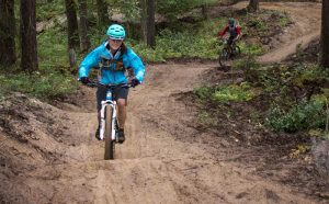 Photo: Evan Matthews Riders of varying skill ride to the bottom of Bacon Trail, seen here. Curtis Pawliuk says the trail needs your help to be packed down, and the best way to do that is to ride.