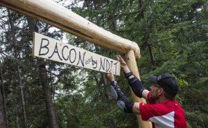 Photo: Evan Matthews Randy Pruden erects the trail's new sign.
