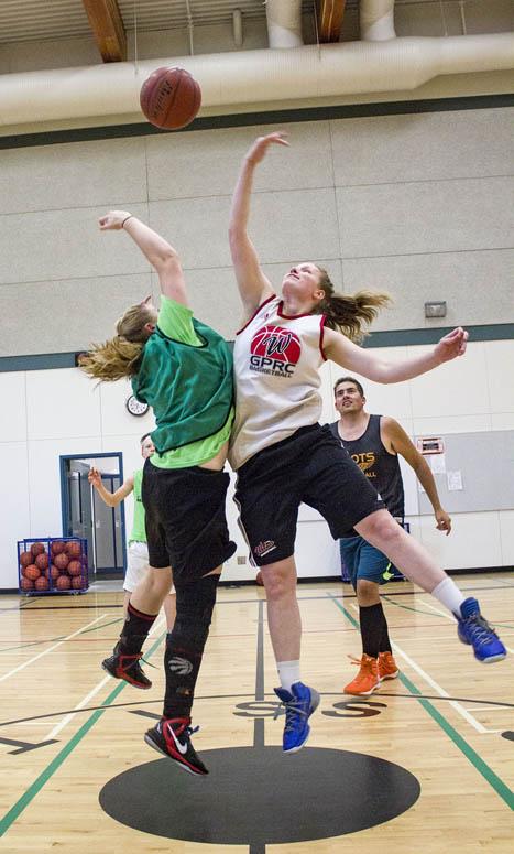 Katlyn Jensen (green) tips off against her coach and mentor for the week, Linnaea VanderZwan.