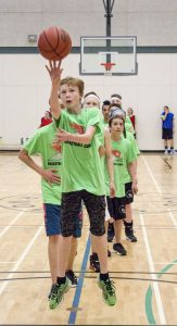 """Ben Dempsey puts focuses into this shot at the free throw line. Sure enough, """"swish,"""" nothing but net."""