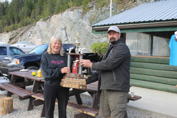 Lorna Griffin is presented her trophy for the Biggest Catch of the weekend by Marina Association president, Owen Torgersen, as she caught a rainbow weighing in at 4.07.