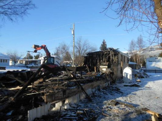 Photo: Darren Heaps After a tragic fire in Hartman Trailer Park claimed the life of 16-month-old Dominic Meek, the community has rallied together in order to support the Meek-Olson family. Regan Lewis is loading debris from the trailer into one of Bob Griffin's dump trucks, seen below.