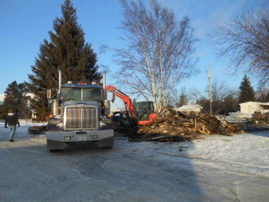 Photo: Darren Heaps Bob Griffin's dumptruck being loaded with debris.