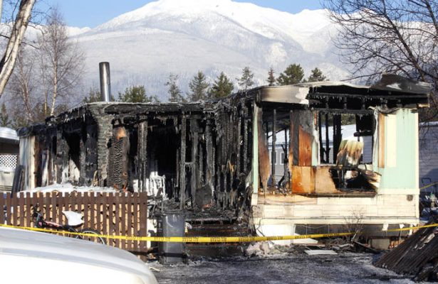 Photo: Evan Matthews The former home of the Meek-Olson family, the day after the blaze occured in Hartman Trailer Park.
