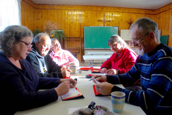 Photo: Evan Matthews Ellen Duncan, Art and Mimi Guiltner, Marian Plummer and Maurice Hill are seen playing Scategories during the first drop-in this winter at the Valemount Anglican Church. Not pictured: Laura Johnson, founding member.
