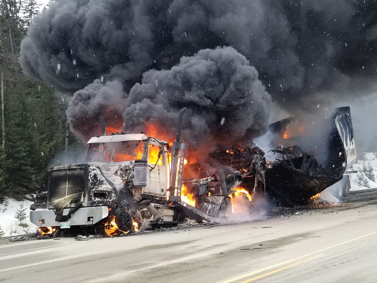 Driver escapes uninjured in truck fire +VIDEO