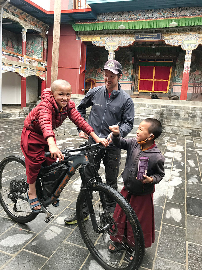 Mountain bike champ finds a home with Buddhist monks